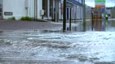 chuva : Slow Motion Sequence Of Flood Water Flowing Into Street