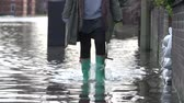 vila : Slow Motion Sequence Of Boots Walking Along Flooded Road
