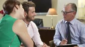 anger : Young Couple Talking To Male Counsellor Stock Footage