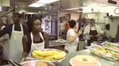 pobreza : Time Lapse Sequence Of Worker In Kitchen Of Homeless Shelter