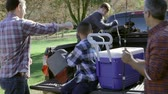 four people : Fathers With Sons Unpacking Truck On Camping Holiday