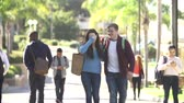 campus : Student Couple Walking Outdoors On University Campus