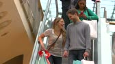 shopping bag sale : Couple On Escalator In Shopping Mall Together