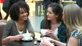 lifestyle shot : Group Of Young Female Friends Meeting In Café Stock Footage