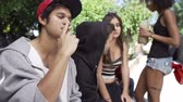cigarro : Gang Of Young People In Urban Setting Drinking Alcohol