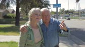 dolly : Senior Couple Walking Along Sidewalk Together