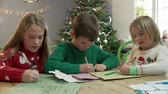 atlamacı : Three Children Writing Letters To Santa Together Stok Video