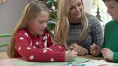 atlamacı : Mother And Children Writing Letter To Santa Together Stok Video