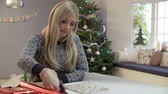 prezent : Woman Wrapping Christmas Gifts At Home