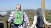 sorridente : Senior Couple On Viewing Platform At The End Of Hike Stock Footage