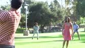 four people : Slow Motion Sequence Of Friends Playing Baseball In Park Stock Footage