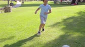 bolas : Young Boy Playing Football In Park Stock Footage