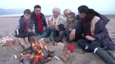 salsichas : Multi Generation Family Having Barbeque On Winter Beach