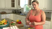 ovos : Overweight Woman Preparing Healthy Meal in Kitchen
