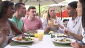 four people : Group Of Friends Enjoying Lunch In Outdoor Restaurant