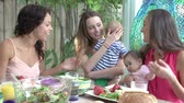 mama : Group Of Mothers With Babies Enjoying Outdoor Meal At Home Wideo