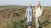 chůze : Senior Couple With Dog Walking Along Coastal Path