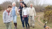 três pessoas : Multi Generation Family On Countryside Walk With Dog