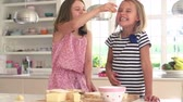 смех : Girls Eating Ingredients Whilst Making Cheese On Toast Стоковые видеозаписи