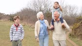 chůze : Grandparents With Grandchildren On Walk In Countryside
