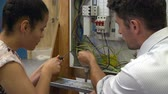 изучение : Teacher Helping Student Training To Be Electrician