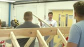 estudantes : Teacher Helping College Students Studying Carpentry Stock Footage