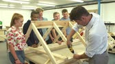 Öğrenciler : Teacher Helping College Students Studying Carpentry Stok Video