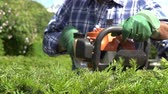 luva : Slow Motion Sequence Of Man Cutting Hedge With Trimmer