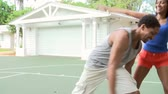 dolly : Slow Motion Sequence Of Couple Playing Basketball Match Stock Footage