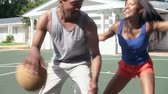 ponto : Slow Motion Sequence Of Couple Playing Basketball Match Stock Footage