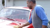 vermelho : Retired Senior Man Cleaning Restored Car