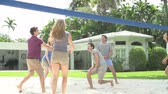 tendo : Group Of Friends Playing Volleyball Match In Slow Motion