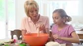 яйцо : Grandmother And Granddaughter Baking Together At Home