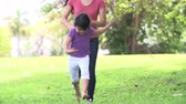 mama : Slow Motion Sequence Of Mother And Daughter Running In Park
