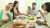 posiłek : Group Of Friends With Babies Enjoying Meal At Home Together Wideo