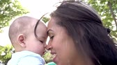 months : Slow Motion Sequence Of Mother Playing With Baby Son In Park