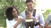 niemowlaki : Slow Motion Shot Of Families With Baby Carriers In Park Wideo
