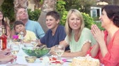 urodziny : Family Group Celebrating Birthday On Terrace In Slow Motion