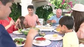 grupo de pessoas : Multi Generation Family Enjoying Meal On Terrace Together