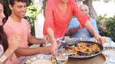 três pessoas : Multi Generation Family Enjoying Paella On Terrace Together