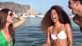 funky : Slow Motion Shot Of Young Friends Having Fun In Sea Together