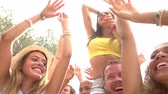 lifestyle shot : Slow Motion Sequence Of People Dancing At Outdoor Party Stock Footage