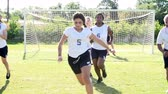 pontapé : Slow Motion Sequence Of Female School Soccer Team Training