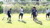 pontapé : Slow Motion Sequence Of Male School Soccer Team Training