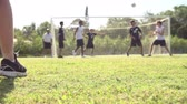 ponto : Slow Motion Sequence Of Male School Soccer Team Scoring Goal