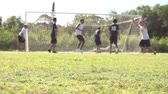 arremesso : Slow Motion Sequence Of Male School Soccer Team Scoring Goal