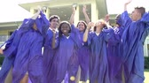 graduate : Slow Motion Sequence Of High School Students At Graduation