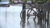 cyklus : Slow Motion Sequence Of Cycle Rack On Flooded Road Dostupné videozáznamy