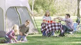 namiot : Family Enjoying Camping Holiday In Countryside Wideo