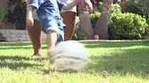 vnuk : Grandfather Playing Football With Grandson In Garden